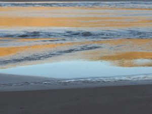 Photo of reflecting sunset on water at San Dunes National Park